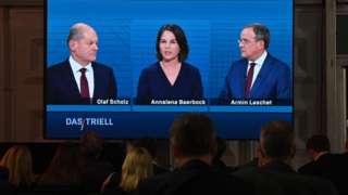 Sosyal Demokratların adayı Olaf Scholz, Yeşiller Partisi'nin adayı Annalena Baerbock ve Muhafazakarların adayı Armin Laschet yanyana...