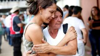 Relatives of those who remain missing following the dam collapse in Brumadinho, Brazil, 26 January 2019