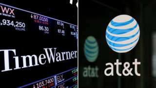 combination photo shows the Time Warner shares price at the New York Stock Exchange and AT^T logo in New York, NY, U.S., on November 15, 2017 and on October 23, 2016 respectively.