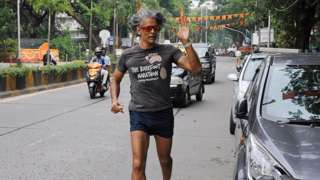Bollywood actor Milind Soman is seen jogging in Mumbai, India, on 26 October 2020