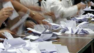 People counting ballots