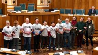 Protesters in the county council chamber