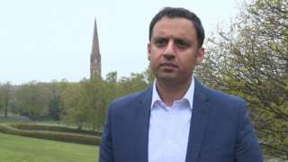 Scottish Labour leader Anas Sarwar stands in a park while campaigning in Glasgow