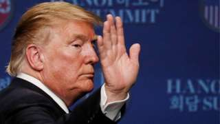 Donald Trump waving to reporters