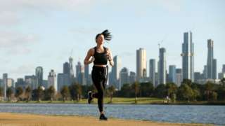 A young woman exercises in Melbourne, Australia