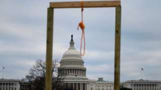 A noose is seen on makeshift gallows as supporters of US President Donald Trump gather on the West side of the US Capitol in Washington DC