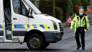 Greater Manchester Police officer and van