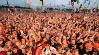 Festivalgoers watch the Pyramid Stage at Glastonbury Festival - 2017