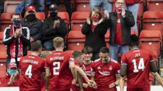 Aberdeen celebrate in front of their fans in their 2-0 win over Dundee United
