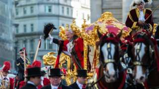 The Lord Mayor of the City of London, Alderman Peter Estlin, waves from his carriage during the Lord Mayor's Show on November 10, 2018 in London, England.
