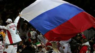 Russian athlete with the Russian flag