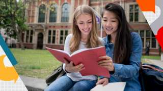 Female students studying outdoors