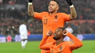 Wijnaldum (bottom) celebrates with Netherland forward Memphis Depay