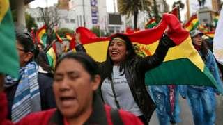 People celebrate after Bolivia's president, Evo Morales, announced his resignation in La Paz,