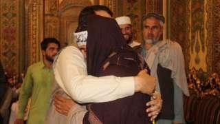 Hayatullah Hayat hugs a member of the Taliban during the June 2018 ceasefire