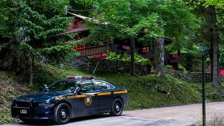Police outside the home where the suspect was found dead