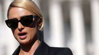 Actress and model Paris Hilton speaks during a news conference outside the U.S. Capitol October