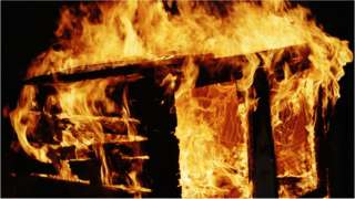 Shed in flames