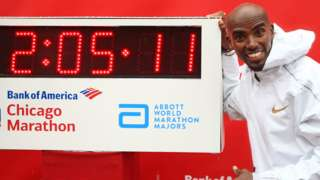 Mo Farah poses with the clock showing his new European record time