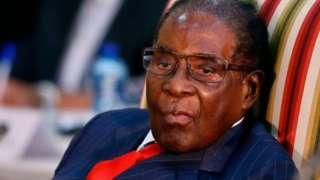 Robert Mugabe ontop chair