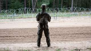 Polish army soldier in front of border between Poland and Belarus. On August 26, 2021 at Border Poland-Belarus