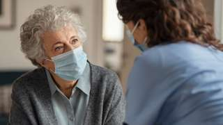 Stock image elderly woman with care worker