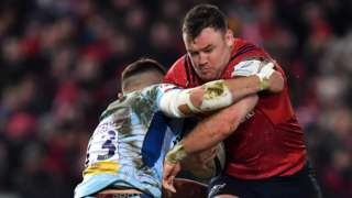 Dave Kilcoyne of Munster is tackled by Henry Slade of Exeter Chiefs