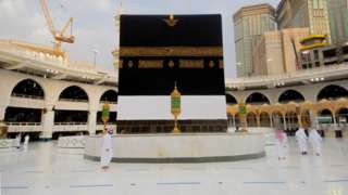 Muslim walk near the Kaaba at the Grand mosque during the Haj, following the outbreak of the coronavirus disease (COVID-19), in Mecca, Saudi Arabia July 26, 2020. Picture taken July 26, 2020
