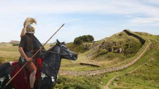 Roman soldier looking at Hadrian's wall