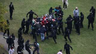 Belarusian law enforcement officers detain participants of an opposition rally
