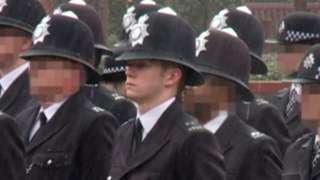 Still from footage of Ben Hannam in police uniform