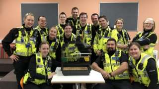 Northamptonshire Police officers pose with Craig the budgie