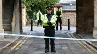 Police at the Abbey gateway of Forbury Gardens in Reading following a multiple stabbing
