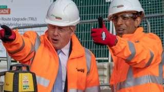 Boris Johnson and Rishi Sunak at a building site