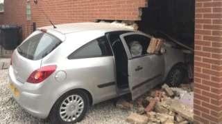 Car in garage wall