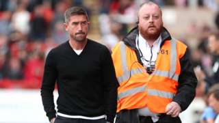 Harry Kewell escorted to the stands after his sending off at Exeter