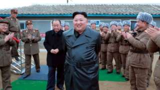 """A state media image said to show Kim Jong-un inspecting the testing of a """"super-large multiple-rocket launcher"""""""