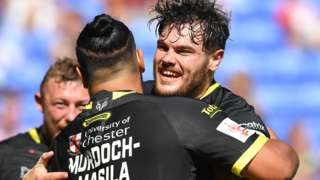Warrington Wolves celebrate a try