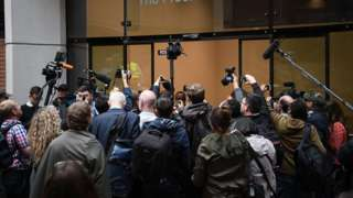 Journalists wait to gain access to the Kensington and Chelsea council meeting