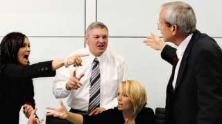 People arguing in an office