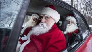 Santas in a car