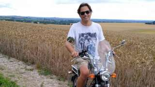 Paul Taylor on his moped