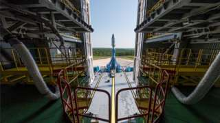 A Soyuz-2.1b rocket booster with a Fregat upper stage and satellites of British firm OneWeb is installed on a launchpad at the Vostochny Cosmodrome in Amur Region, Russia.