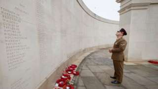 A man pays his respects at the National Memorial Arboretum in Alrewas in Nov 2020