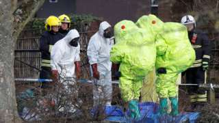Officials in protective suits examine the area where Mr Skripal and his daughter were found