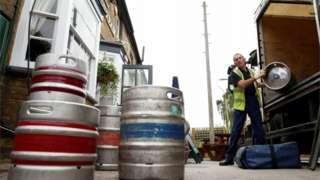 A man delivery barrels of beer