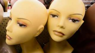 Wigs are displayed in a large wig salesroom in Finsbury Park, north London, on September 10, 2013.