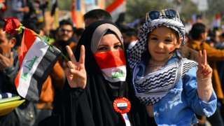 An Iraqi woman and a child take part in anti-government protests in Najaf, 28 January