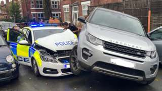 Police car damaged by Land Rover