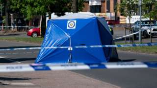 A police tent at the scene on College Road, Kingstanding, north of Birmingham,